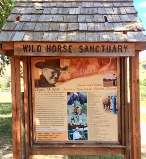 Sign describing purpose and history of wild horse sanctuary